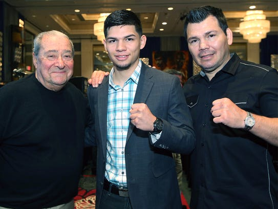 Top Rank promoter Bob Arum, left, stands with boxer