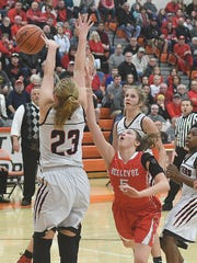 Gabby Turner of Bellevue puts up a shot as she falls