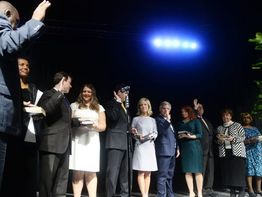 Shreveport City Council members take the oath of office Saturday morning at the Shreveport Convention Center.