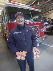 Poulsbo Fire Lieutenant Kurt Serwold holds some of