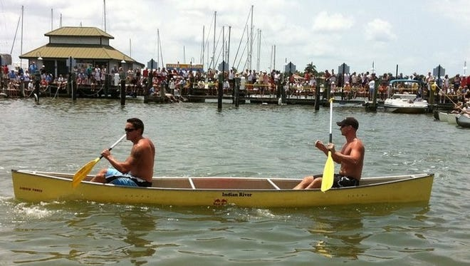 Josh Marzucco, 31, (left) and Jim DePalo, 30, shown in this undated photo from the Great Dock Canoe Race, have won the Ambitious Amateurs division of the event several times. This year they hope to take the title in the Practically Professionals race.