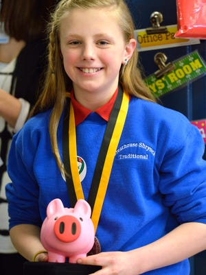 Grace Davis receives the Prudential Spirit of Community Award in recognition for her idea,  Piggies for Preemies, which has raised more than $140,000 over the past four years to care for premature babies.