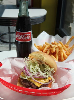 A classic cheeseburger, fries and retro bottle of Coke at POW! Burger in New Rochelle.