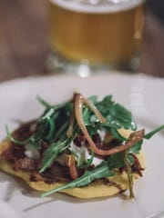 Flatbread pizza with sumac oil and shaved Benton's country ham topped with arugula is a dish by Anna Bogle that was served at the Dancing Bear Lodge and Appalachian Bistro's Snowdown event.
