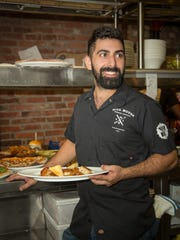 Chef Dan Crocco is shown in his element at the Mill House kitchen.