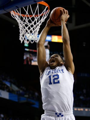 Kentucky forward Karl-Anthony Towns jams in the second half. The University of Kentucky Men's Basketball team hosted Georgetown College, Sunday, Nov. 09, 2014 at Rupp Arena in Lexington. Photo by Jonathan Palmer, Special to the CJ