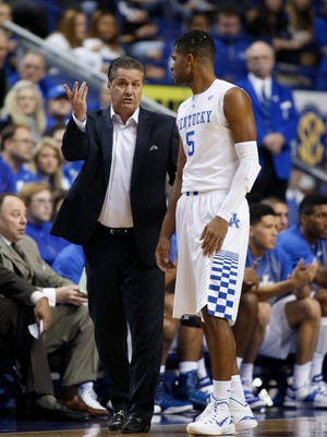 Kentucky head coach John Calipari, left, talks with guard Andrew Harrison during a break in the action.The University of Kentucky Men's Basketball team hosted Georgetown College, Sunday, Nov. 09, 2014 at Rupp Arena in Lexington. Photo by Jonathan Palmer, Special to the CJ
