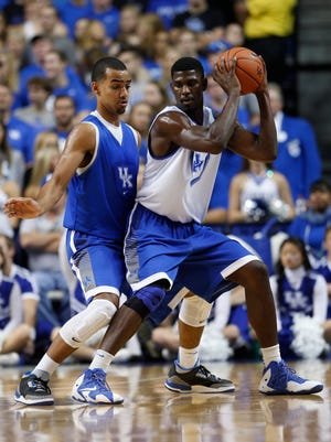 Kentucky forward Trey Lyles, left, battles with forward Alex Poythress in the second half. Kentucky's Blue White Scrimmage was held, Monday, Oct. 27, 2014 at Rupp Arena in Lexington . Photo by Jonathan Palmer, Special to the CJ