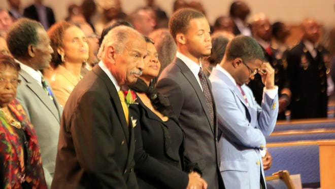From left, U.S. Rep. John Conyers, Monica Conyers, Carl Conyers and John Conyers III at Greater Grace Temple in Detroit on Sept., 29, 2013.