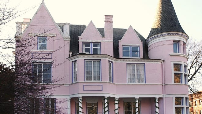 The Pink Palace in St. James Court, shown here all dressed up for Christmas, is for sale for $735,000.