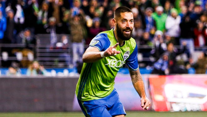 Clint Dempsey celebrates after scoring a goal against the Houston Dynamo.