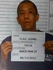 This photo provided by the New Mexico Corrections Department shows inmate Lionel Clah. The Department of Corrections says Clah escaped with inmate Joseph Cruz from a prisoner transport van on Wednesday, March 9, 2016, in the Roswell area.