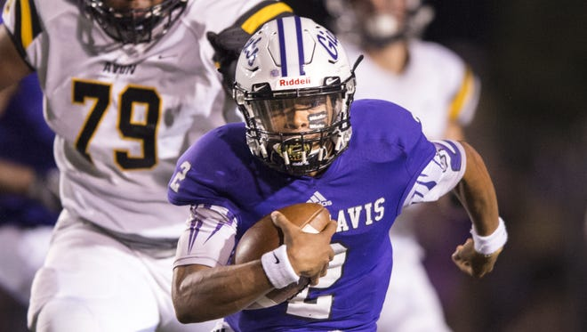 Ben Davis High School senior Reese Taylor (2) looks for an opening in the Avon defense as he rushes the ball out of the backfield during the second half of an IHSAA high school football game at Ben Davis High School, Friday, August 25, 3017. Ben Davis won 52-20.