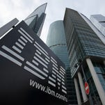 "A sign for International Business Machines Corp. (IBM) stands outside offices at the Moscow International Business Center, also known as ""Moscow City.""."