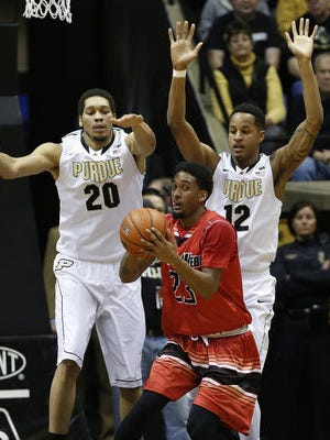 Purdue's A.J. Hammons (20) and Vince Edwards defend Gardner-Webb's Adonis Burbage on Monday.