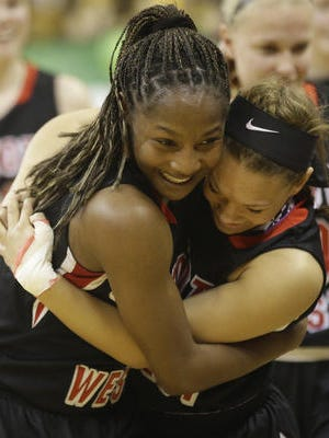 Lakota West teammates Nia Staples (left) and Sarah Jones celebrate the state title in March.