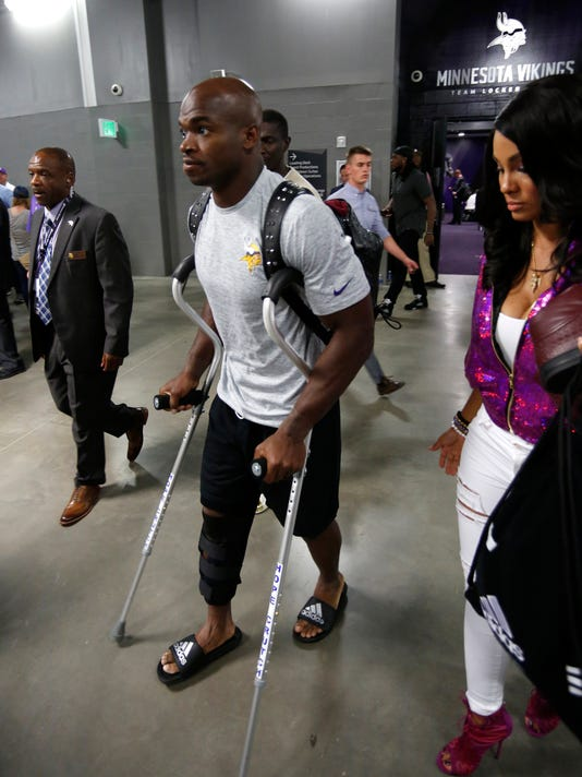 Minnesota Vikings running back Adrian Peterson leaves U.S. Bank Stadium on crutches after an NFL football game against the Green Bay Packers Sunday, Sept. 18, 2016, in Minneapolis. The Vikings won 17-14. (AP Photo/Andy Clayton-King)