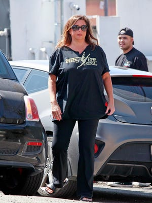 Abby Lee Miller promotes her dance company on a T-shirt as she is seen out for lunch for the first time after serving 8 months in prison, March 29, 2018.