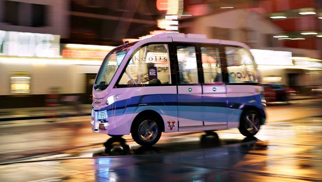 A Navya Arma autonomous vehicle drives down a street in Las Vegas in January 2017. The driverless electric shuttle has begun carrying passengers in a test program in a downtown Las Vegas entertainment district.