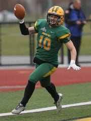 Brockport's defensive back Jake O'Connell, celebrates after running his interception in for a touchdown in the second quarter against Plymouth State.
