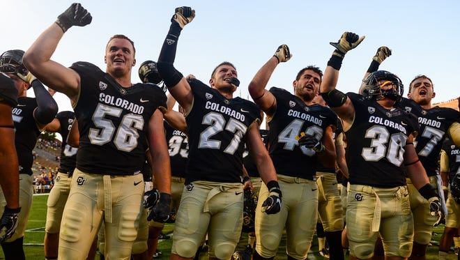 Colorado Buffaloes players sing the fight song after a 56-7 win over the Idaho State last week.