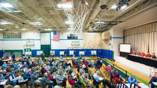 Richmond's town meeting is held in the gym at the Camel's Hump Middle School on Tuesday, March 7, 2017.