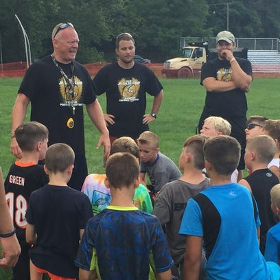 Lancaster senior football player Luke Sheridan gives instructions to campers using The Difference Machine during Tuesday's Junior Gale Football Camp.