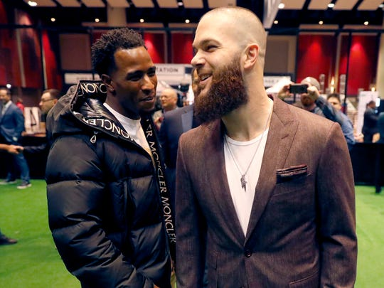Chicago White Sox's Dallas Keuchel, right, talks with Tim Anderson during the team's annual fan convention Friday, Jan. 24, 2020, in Chicago. (AP Photo/Charles Rex Arbogast)