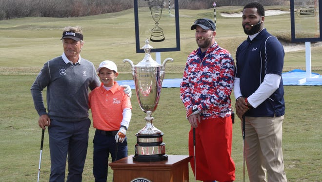 Senior PGA Skills Challenge featuring, left to right: professional Bernhard Langer, Dylan Walters, a 10-year-old player in the PGA Junior League, PGA Hope Graduate Sgt. Jason Fuller and former Michigan football standout Braylon Edwards.