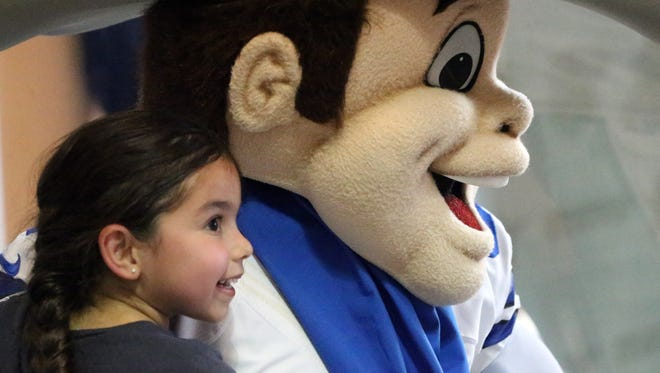 Elizabeth Prado, 5, gets her photo taken with Rowdy, the Dallas Cowboys official mascot, during an appearance Friday at the Dallas Cowboys Official Pro Shop at The Outlet Shoppes at El Paso.