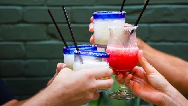Toasting Margaritas at Happy Hour at Outdoor Cafe