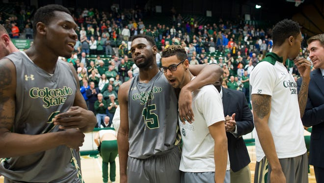 CSU players, from left, Emmanuel Omogbo, Tiel Daniels, Gian Clavell and Fred Richardson, celebrate Saturday's win over Air Force at Moby Arena.