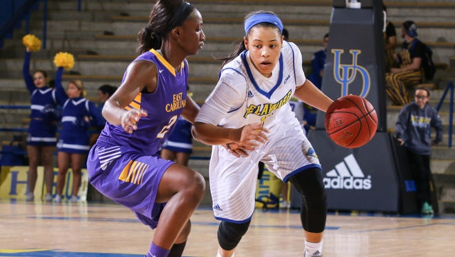 Blue Hens guard Erika Brown (3) dribbles down court in the first half of a basketball game between Delaware and the ECU Pirates Sunday at The Carpenter Center.