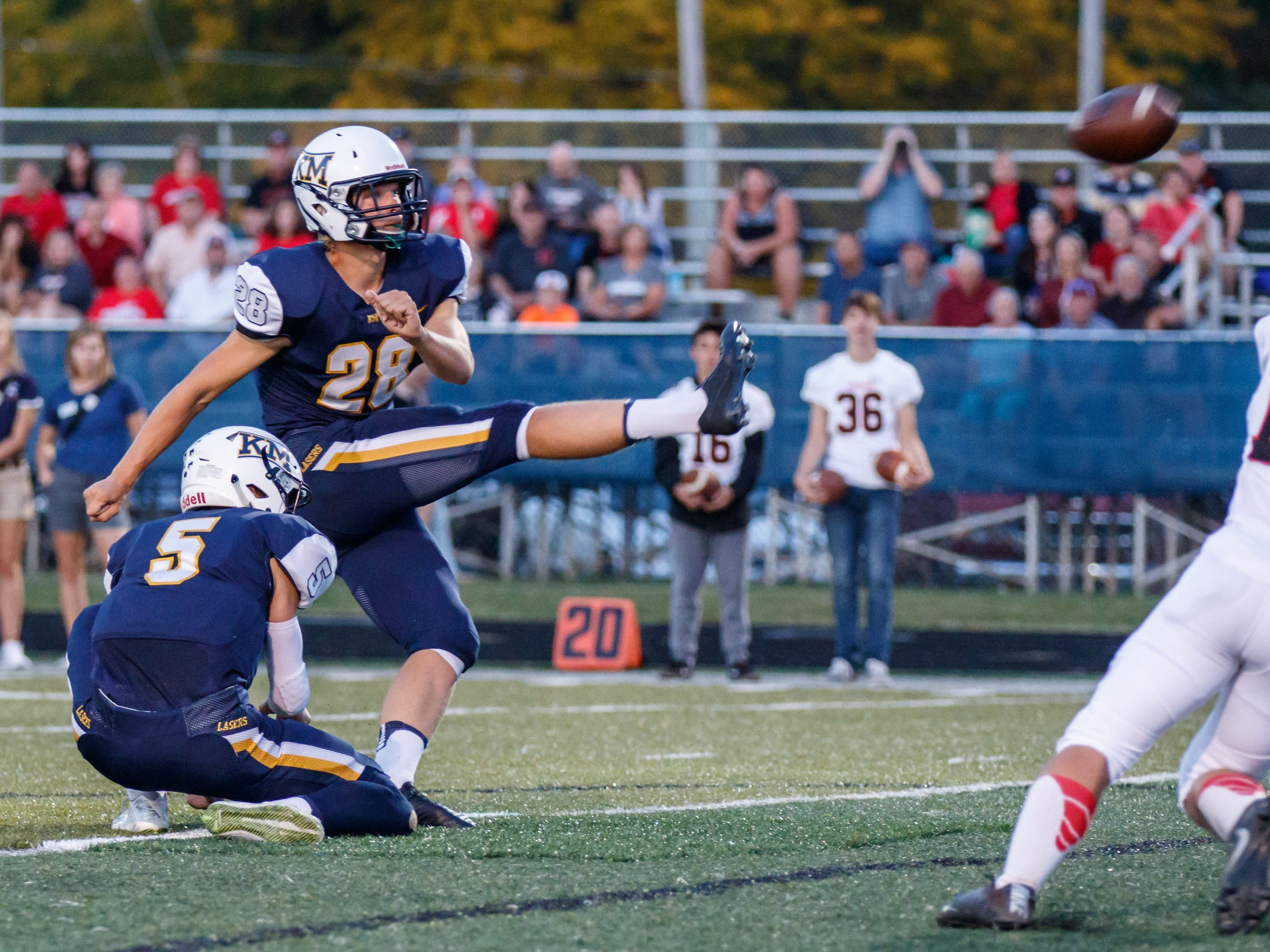 Kettle Moraine kicker Blake Wilcox (28) drills a PAT through the uprights during the game at home against Muskego on Friday, Sept. 15, 2017.
