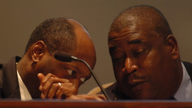 Ernest Brooks II talks with Harvey Buchanan during a Jackson City Council meeting in this 2009 file photo.