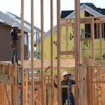 Workers build walls of a new home at a housing development in San Mateo, California.  The Commerce Department reported Friday that new home construction was up 18% in 2013 from the year before. (Photo by Justin Sullivan/Getty Images) ORG XMIT: 166911614 ORIG FILE ID: 166751411
