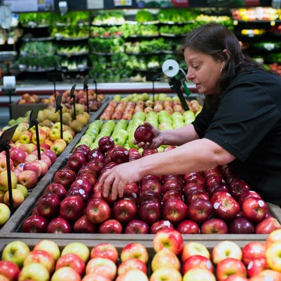 Produce manager Debbie Green culls apples for a food