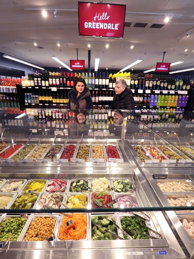 A salad bar, olive bar, wines and more are offered