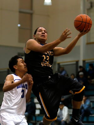 Navajo Prep's Nachae Nez drives to the basket on Friday during a game against Navajo Pine at the Eagles Nest in Farmington.