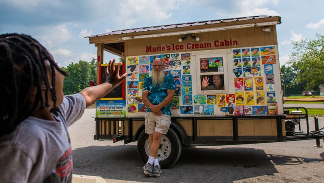 Zamari Cross, 2, waves to Gary and Marie Caudell, owners of Marie's Ice Cream Cabin. The couple visits Kids Depot every Thursday.