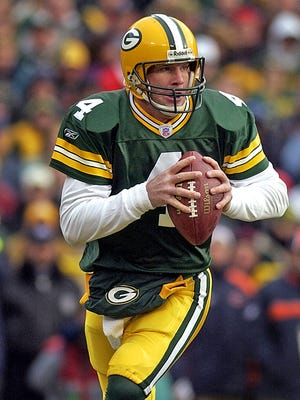 Green Bay Packers quarterback Brett Favre looks to make a pass during a game against the Chicago Bears at Lambeau Field in 2003.