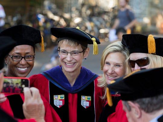Cornell University President Elizabeth Garrett, center,