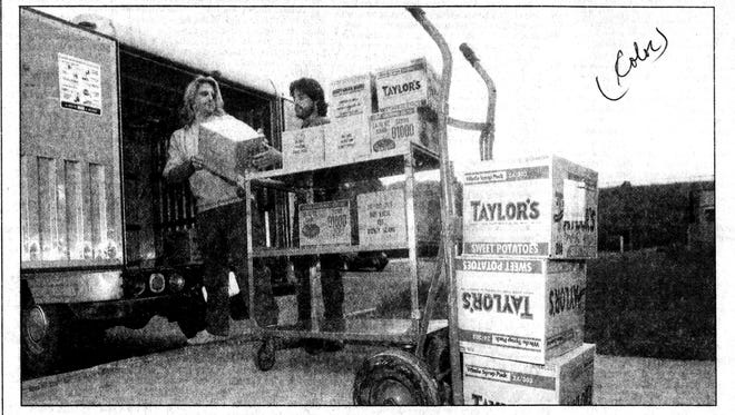 Workers at the Volunteers of America ready food for the Thanksgiving meal in 1990.