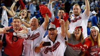 Cleveland Indians fans celebrate after the Cleveland Indians beat the Toronto Blue Jays in game five of the 2016 ALCS playoff baseball series at Rogers Centre on Oct. 19.