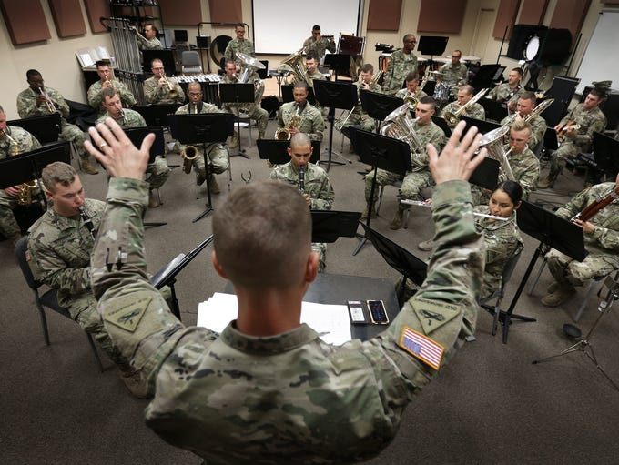 The 1st Armored Division Band, led by Capt. Joel DuBois,