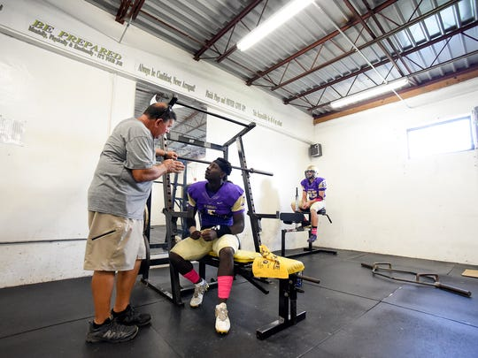 Okeechobee High School assistant coach Glenn Attaway talks with running back/defensive end JaJuan Cherry Monday, Oct. 16, 2017, in the locker room before their team's high school football game against Sebastian River at Okeechobee High School.