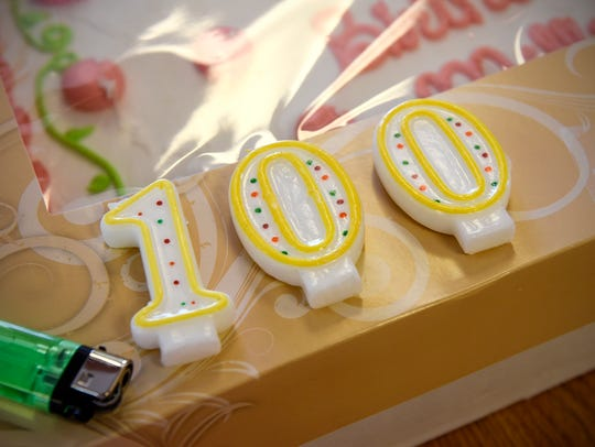 Candles are ready to be lit during a 100th birthday