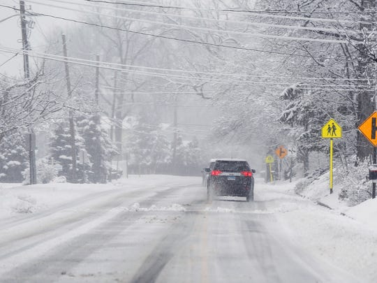 3:15 p.m. Cars drive along a snow covered Little Tor Road in New City on Wednesday, March 7, 2018.