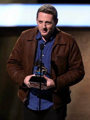 "Sturgill Simpson accepts the award for best country album for ""A Sailor's Guide To Earth"" at the 59th annual Grammy Awards on Sunday, Feb. 12, 2017, in Los Angeles."