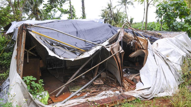 A home remains in ruin in August 2015, after being damaged by falling tree branches during Typhoon Dolphin.